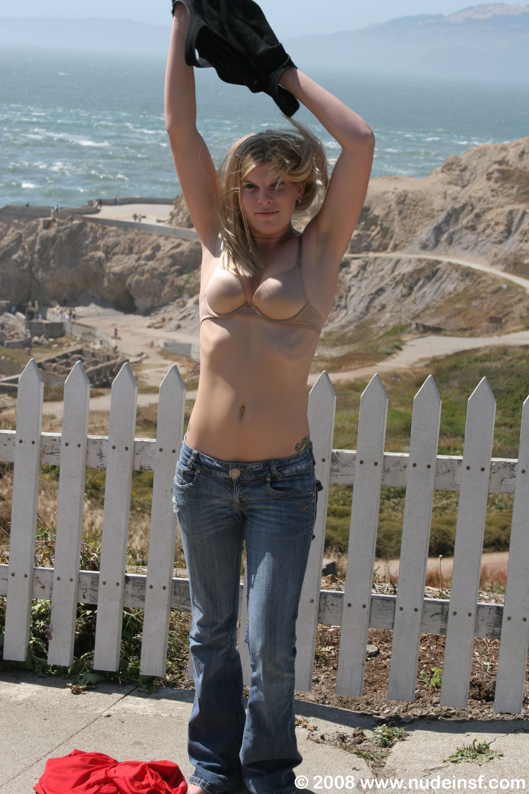 Super hot California surfer girl Janis gets naked at the top of Sea Cliff  overlooking the Pacific Ocean and the Golden Gate Bridge. It's a big  tourist area, ...